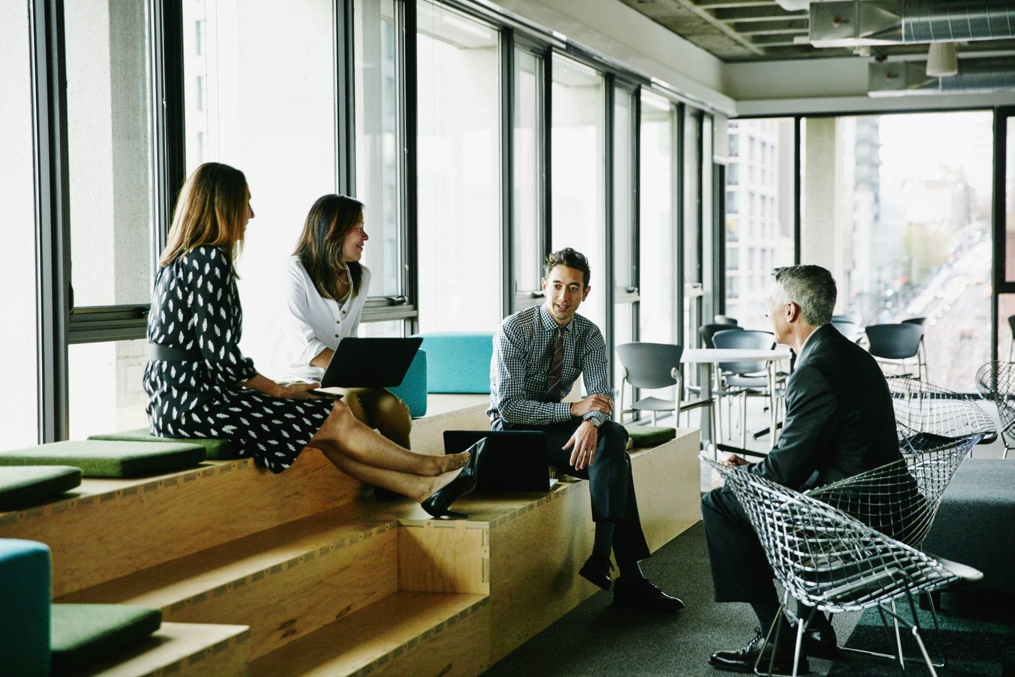 Colleagues having informal meeting in office